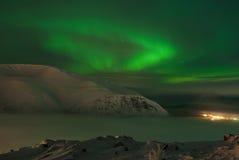 Dynamic Aurora polaris. A nal mountain royalty free stock images