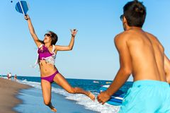 Dynamic beach tennis jump. Royalty Free Stock Images