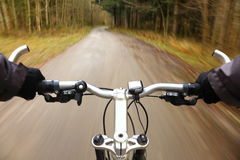 Dynamic biking. Dynamic view from a bike to the road Royalty Free Stock Image