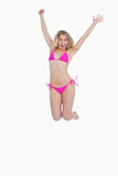 Dynamic blonde woman energetically jumping Royalty Free Stock Photography
