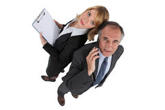 Dynamic business couple Stock Photos