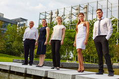 Dynamic business team standing outdoors Royalty Free Stock Images