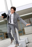 Dynamic businessman. Happy successful businessman jumping in the air royalty free stock photography