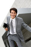 Dynamic businessman. Happy successful businessman jumping in the air royalty free stock images
