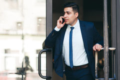 Dynamic businessman and active lifestyle. Work and life balance concept Stock Images