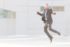 Dynamic businessman jumping outdoor Royalty Free Stock Photography