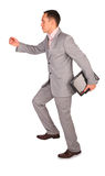 Dynamic businessman with notebook. On white Royalty Free Stock Image