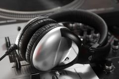 Dynamic closed headphones on mixer Royalty Free Stock Image