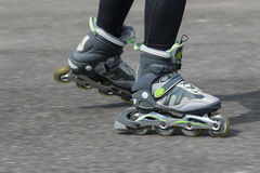 Dynamic closeup view of a woman on inline skates Royalty Free Stock Photography