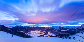 Dynamic clouds over valley at winter. Night in tirol mountains Stock Photo