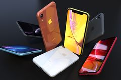 Dynamic composition of iPhone XR colorful smartphones falling royalty free stock images