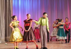 Dynamic dancing teenagers Stock Images
