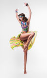 Dynamic dancing woman in colourful necklace Royalty Free Stock Image