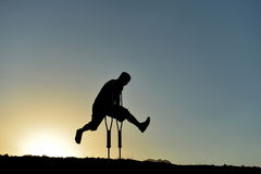 Dynamic, energetic and disabled. Silhouette disabled man ;Dynamic, energetic and disabled stock images