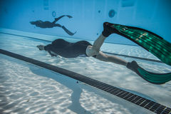 Dynamic With Fins (DYN) Performance from Underwater. Montreal, CANADA - May 30th, 2015. Official AIDA Freediving Pool Competition Taking place in the Parc Jean Royalty Free Stock Photography
