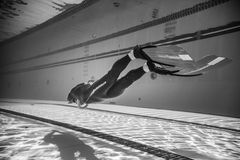 Dynamic with Fins Freediver Performance from Underwater Stock Images