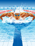 Dynamic and fit swimmer in cap breathing performing the butterfly stroke. Young man in swimming cap and goggles swim using breaststroke technique Stock Photo