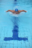 Dynamic and fit swimmer performing the butterfly s Stock Photos