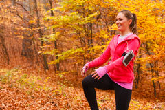 Dynamic girl stretching in forest. Royalty Free Stock Photos