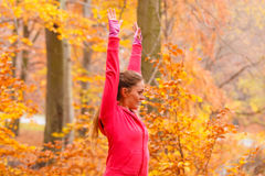 Dynamic girl stretching in forest. Stock Image