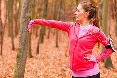 Dynamic girl stretching in forest. Royalty Free Stock Photography