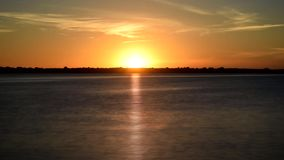 Dynamic golden sunrise over river in the morning at dawn stock footage