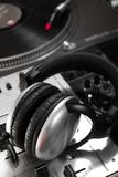 Dynamic headphones laying on mixing controller Stock Image