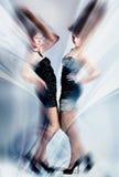Dynamic magic women in dress Stock Photos