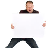 Dynamic man with bilboard. Dynamic man holding blank billboard on white background Royalty Free Stock Photos