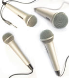 Dynamic mic. A dynamic mic with a curled cable over white Royalty Free Stock Photo