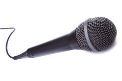 Dynamic mic. A dynamic mic with a curled cable isolated on white background Royalty Free Stock Photos