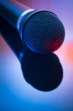 Dynamic microphone. With reflection in mixed red blue light Royalty Free Stock Images