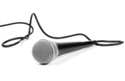 Dynamic microphone. With cable on a white background Royalty Free Stock Image
