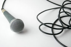 Dynamic microphone with cable on white background Stock Photos