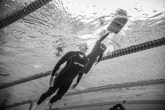 Dynamic no Fins Freediver Going Out of the Water from Underwater Stock Image