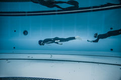 Dynamic no Fins Freediver during Performance from Underwater Royalty Free Stock Photos