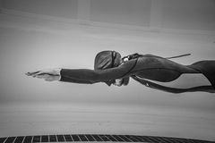 Dynamic no Fins Freediver during Performance from Underwater Stock Images