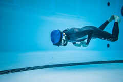 Dynamic no Fins Freediver during Performance from Underwater Stock Photo