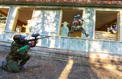 Dynamic paintball battle of three players outdoors Stock Images