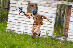 Dynamic paintball sportsman on the run Royalty Free Stock Image
