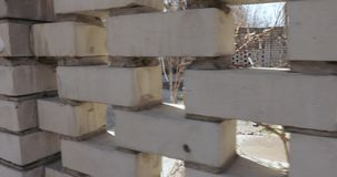 Brick fence made of white brick. Dynamic panorama along a white brick fence stock video