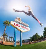 Sporty woman jumping high in Las Vegas royalty free stock image