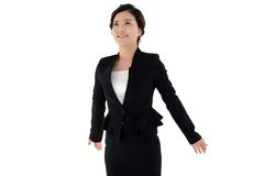Dynamic pose of business woman looking at the sky Royalty Free Stock Images