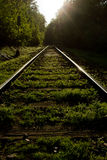 Dynamic rails. Rails with front light. Very dynamic, heading to the bright future Stock Photos