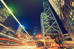 Dynamic rays of light on the urban street. Hong Kong, China.Night  view on bright lightened street. Dynamic rays of light on the urban street Royalty Free Stock Image