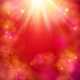 Dynamic red abstract background with sunburst. Dynamic red abstract background with a bright star burst or sunburst with rays of light and copyspace, square Royalty Free Stock Image