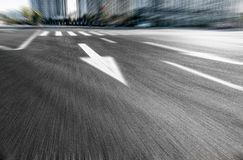 A dynamic road. Pointing to the car ads background images with arrows Stock Photo
