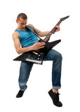 Dynamic rock star. Picture of a dynamic rock star playing an elctric guitar Royalty Free Stock Images
