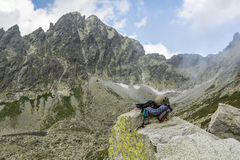 Dynamic rope, helmet, carabiners, climbing harness and descender on the rock in Tatra Valley Stock Photo