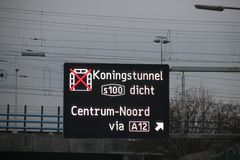 Dynamic route information panel warns for closed tunnel named Koningstunnel on S100 in The Hague on highway A4. Dynamic route information panel warns for closed royalty free stock image